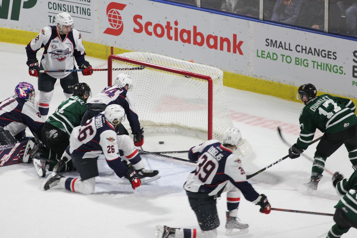 Nathan Dunkley scores the second of his two goals for the London Knights in a 5-0 win in Game 2 of their opening-round series against the Windsor Spitfires.