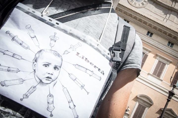 A protestor speaks out against mandatory vaccination in Italy in July 2017. Italy's mandatory vaccination law came into effect in March 2019.