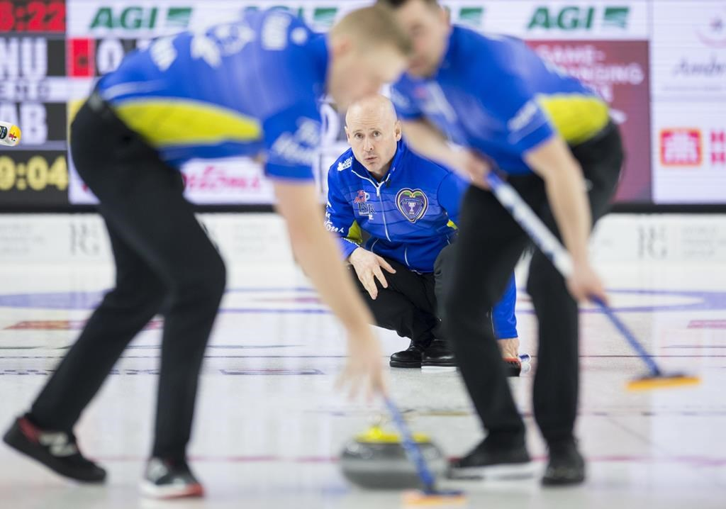 Team Alberta skip Kevin Koe looks on as lead Ben Hebert and second Colton Flasch sweep during the 12th draw against team Nunavut at the Brier in Brandon, Man. Wednesday, March 6, 2019.