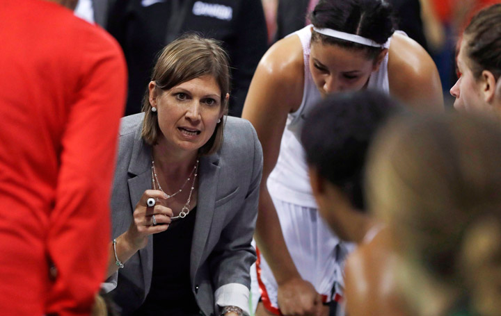 Canada head coach Lisa Thomaidis talks to the team during the second half of a women's basketball game against Serbia at the Youth Center at the 2016 Summer Olympics in Rio de Janeiro, Brazil, Monday, Aug. 8, 2016.