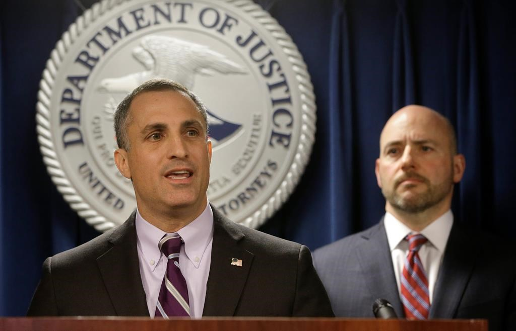 FBI Special Agent in Charge Boston Division Joseph Bonavolonta, left, and U.S. Attorney for District of Massachusetts Andrew Lelling, right, face reporters as they announce indictments in a sweeping college admissions bribery scandal.