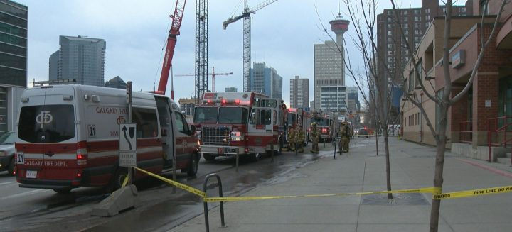 Crews responded to a downtown Calgary building fire that evacuated 200, displaced some and injured none on Tuesday.