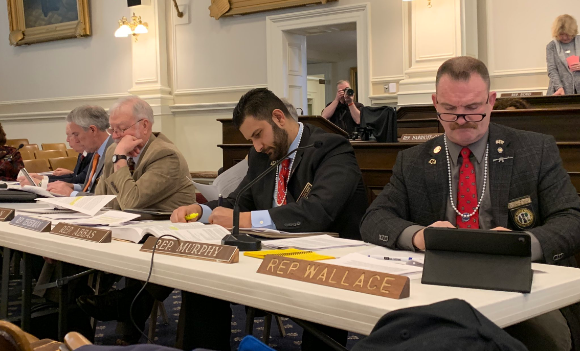 New Hampshire state politicians wear pearls as their committee debates gun control on March 5, 2019.