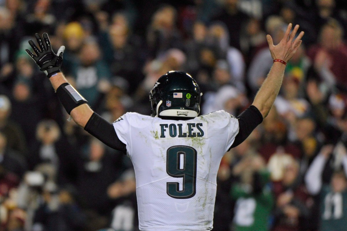 Philadelphia Eagles quarterback Nick Foles (9) reacts to wide receiver Nelson Agholor's touchdown during the second half of the NFL football game against the Washington Redskins, Sunday, Dec. 30, 2018 in Landover, Md.