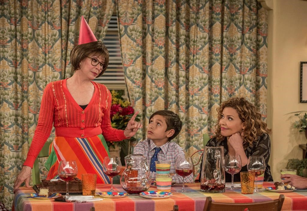 Rita Moreno, from left, Marcel Ruiz and Justina Machado in a scene from 'One Day At A Time.'.