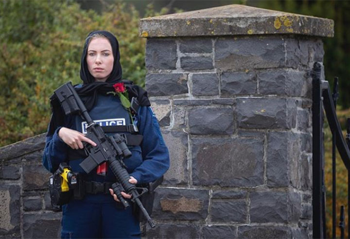 Photographer Alden Williams with New Zealand's Stuff news outlet captured this image of Whanganui Police Constable Michelle Evans standing guard outside of the Christchurch Memorial Park Cemetery on March 21, 2019.