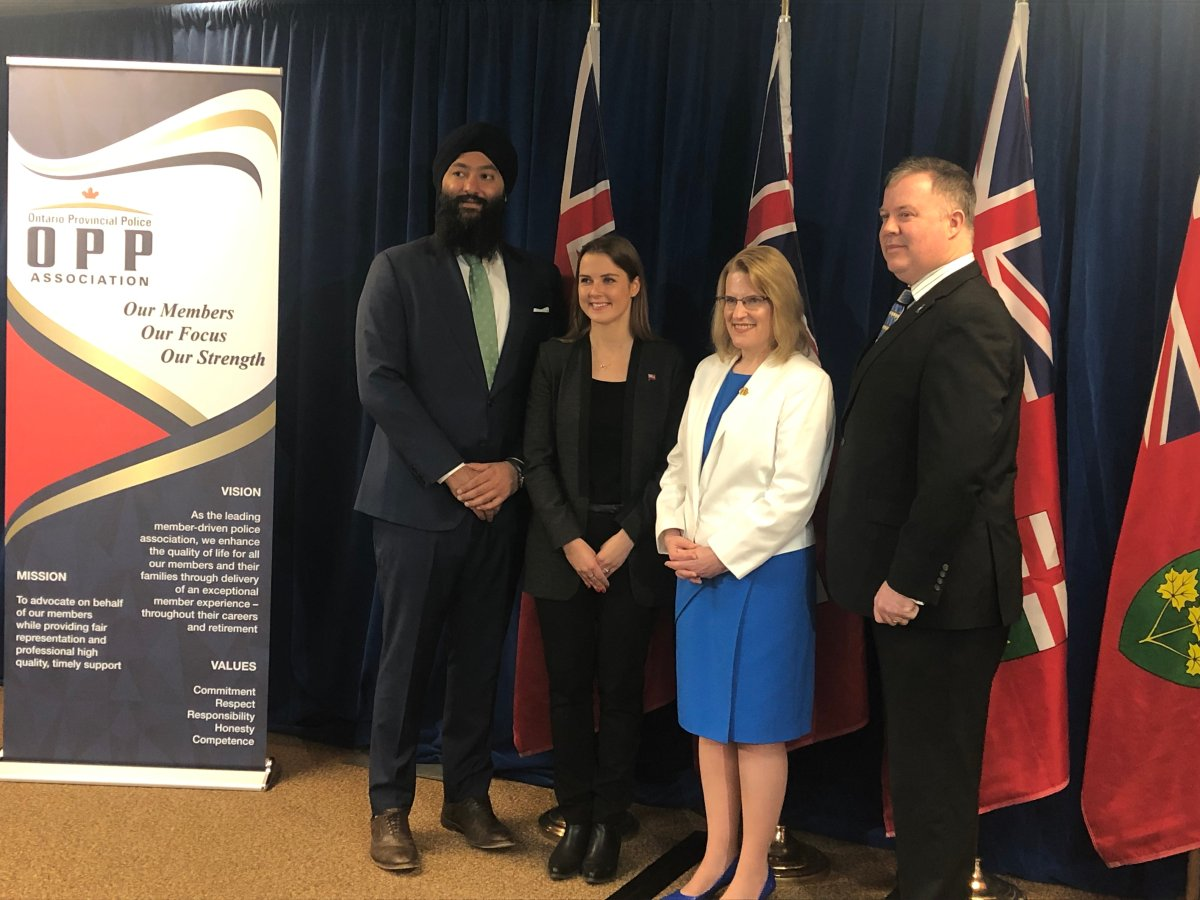 Minister of Community Safety and Correctional Services, Sylvia Jones, (centre) announced the details of a new mental health supports program for OPP officers on Friday, March 29, 2019 in Barrie, Ont.
