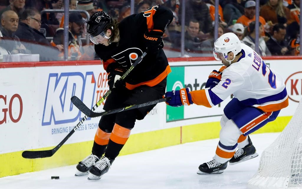 Philadelphia Flyers' Nolan Patrick, left, tries to keep the puck away from New York Islanders' Nick Leddy during the second period of an NHL hockey game, Saturday, March 23, 2019, in Philadelphia. (AP Photo/Matt Slocum).