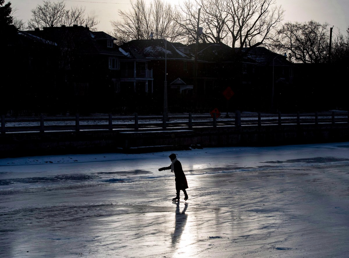 People skate under the Queen Elizabeth Driveway to Paterson Creek on the Rideau Canal Skateway on its opening day, in Ottawa on Sunday, Dec. 30, 2018. The Rideau Canal is a UNESCO World Heritage Site.