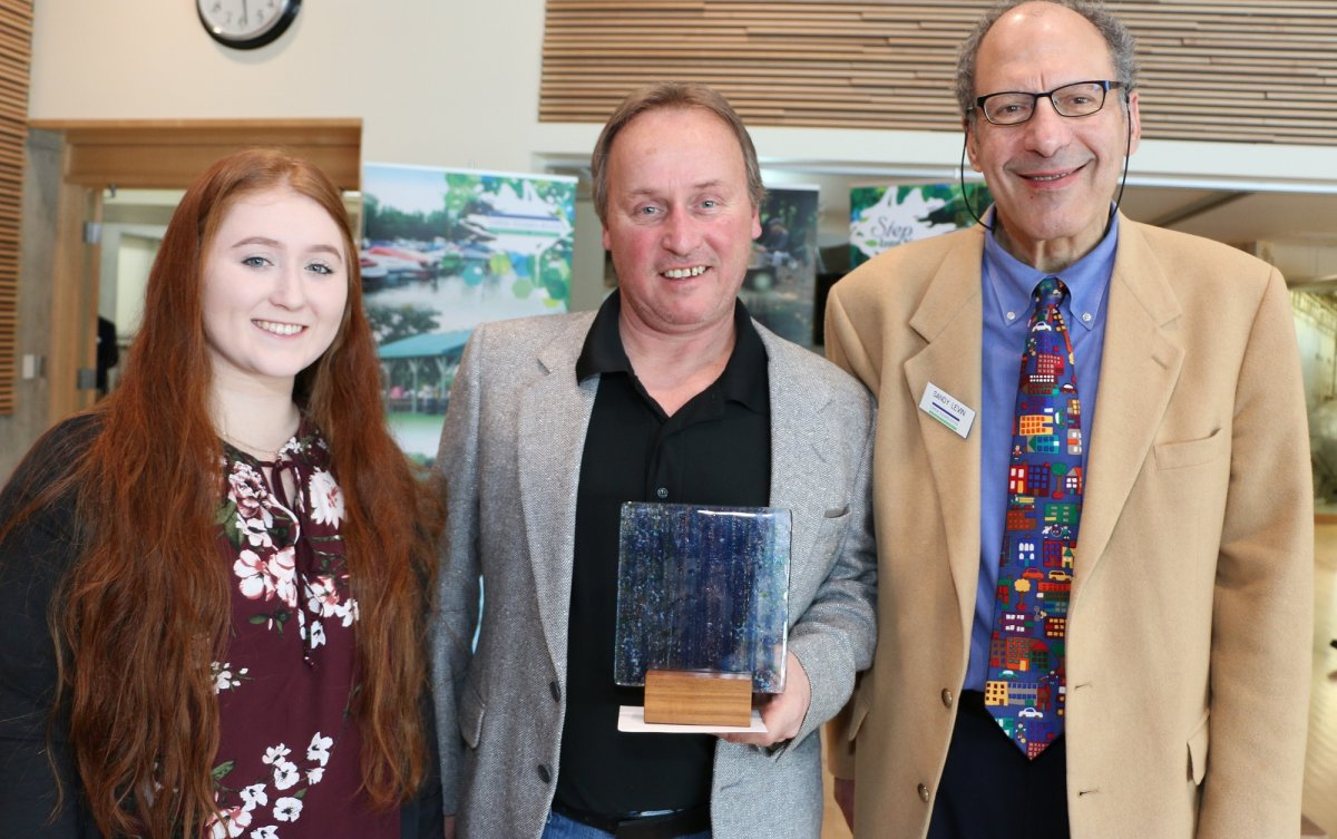 Todd Sleeper (centre) poses with his 2019 UTRCA Community Conversation Award alongside his daughter, Cassandra (left).