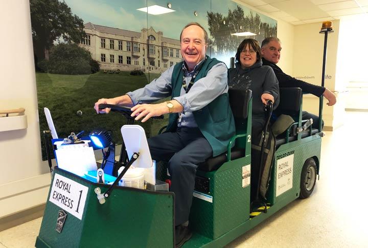 Volunteer driver Bert Gogal (left) gives people a lift on the new Royal Express at Royal University Hospital.