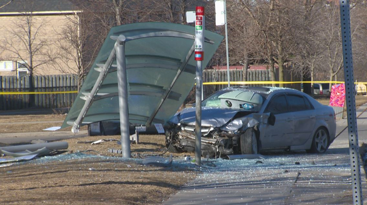 One of the vehicles involved in the collision crashed into a bus shelter.