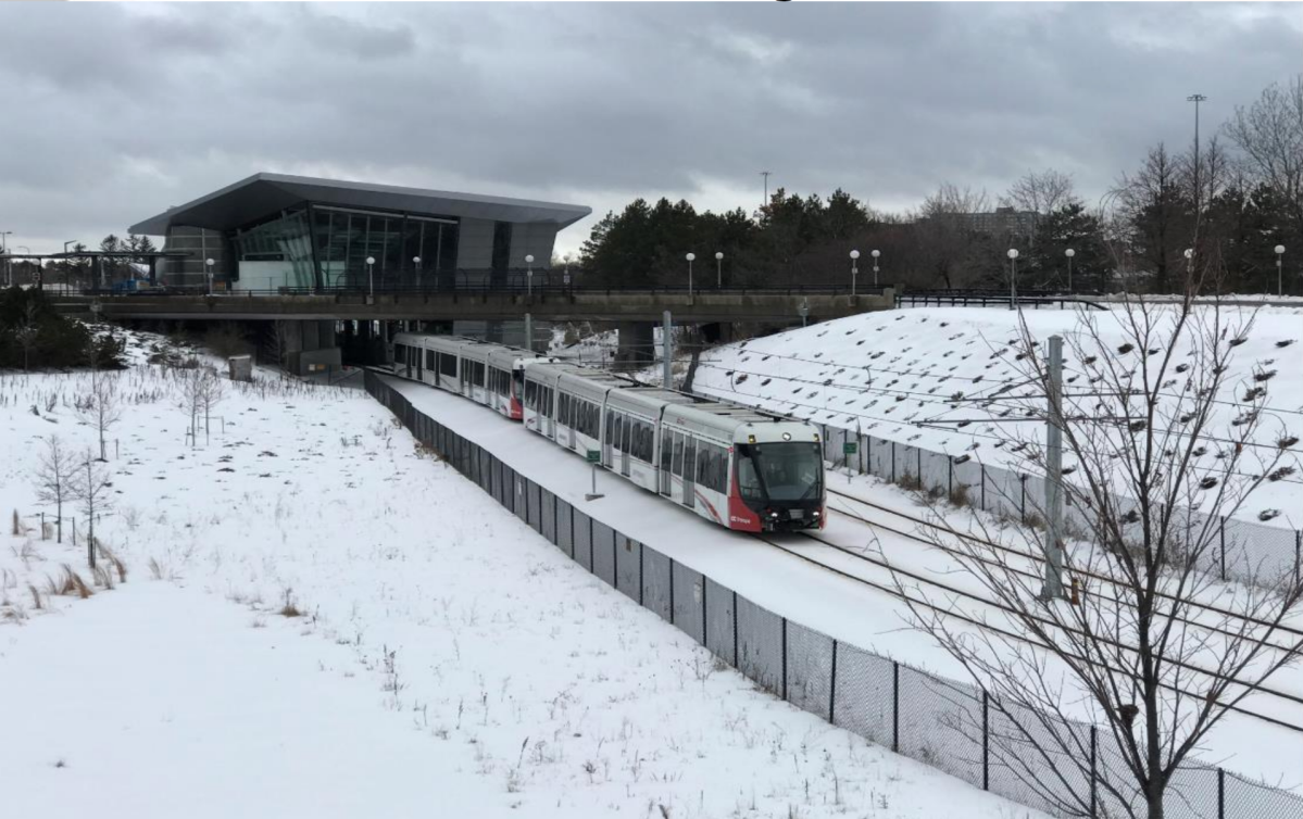 An image of an LRT train set on the tracks during the wintertime in Ottawa.