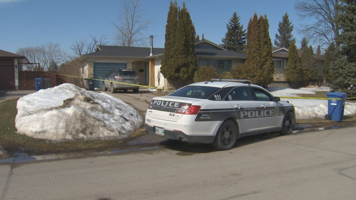 A Winnipeg police cruiser parked in front of a Southdale home where an injured woman was found.