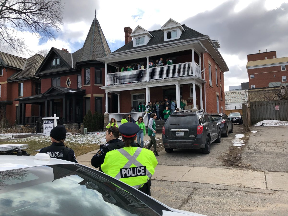 London police attend a St. Patrick's Day house party on Central Ave.