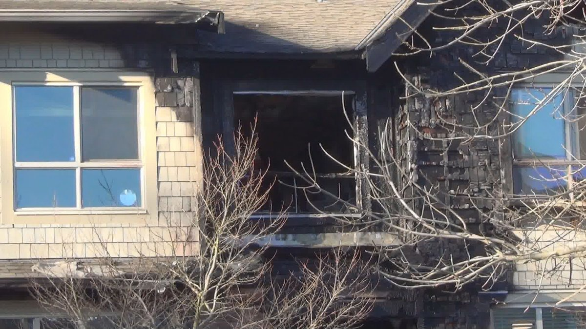A man suffered second degree burns and two other people were taken to hospital for smoke inhalation from this fire in Surrey on Monday.