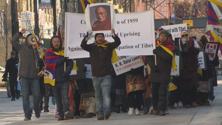 Calgarians made their way from city hall to the Chinese consulate on Sunday to rally behind Chinese-occupied Tibet.