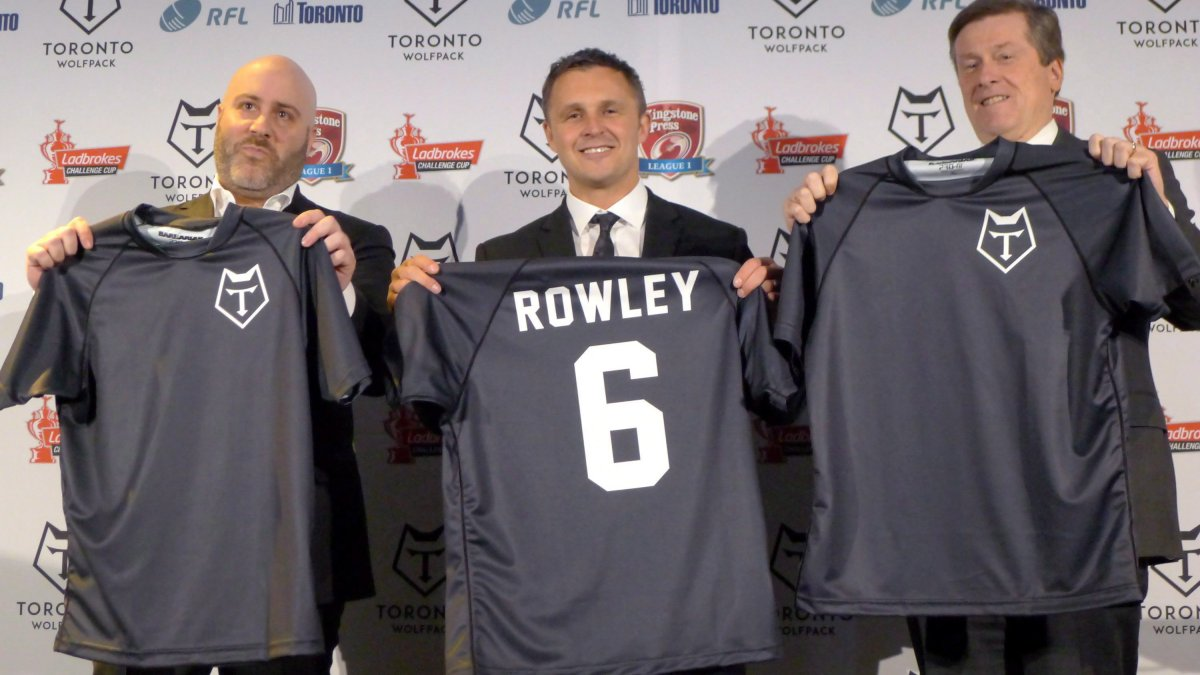 Eric Perez, the founder and CEO of the Toronto Wolfpack (left), Wolfpack head coach Paul Rowley and Toronto Mayor John Tory hold up jerseys of the new rugby league team in Toronto, Wednesday, April 27, 2016. Perez, who helped bring professional rugby league to North America in the form of the Toronto Wolfpack, now has an ownership stake in another club.