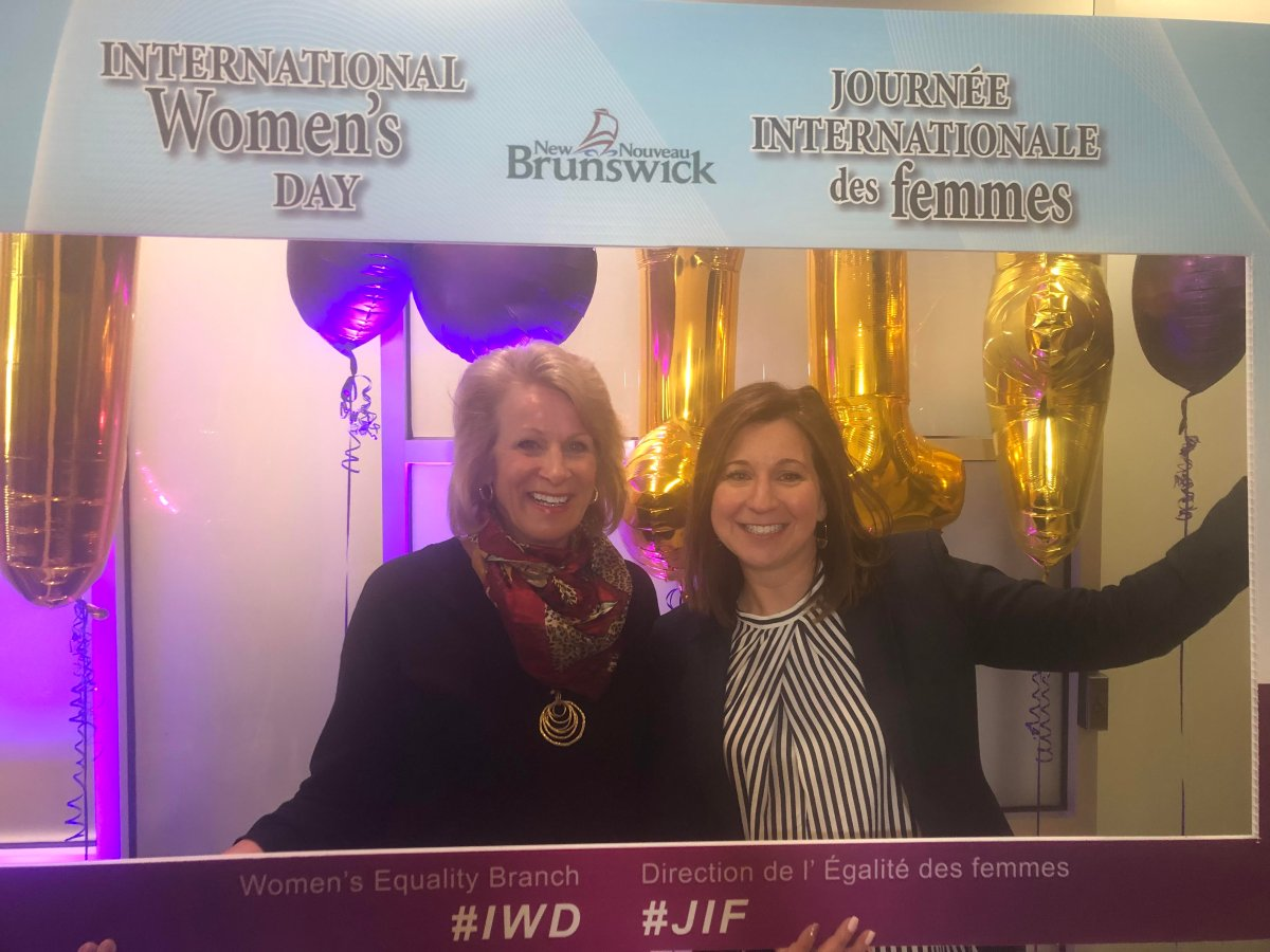 New Brunswick Attorney General Andrea Anderson-Mason and Service New Brunswick Minister Sherry Wilson celebrate International Women's Day.