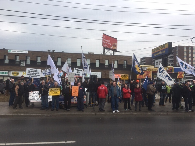 """Liberal MP Bob Bratina says """"false accusations"""" have caused a rally at his constituency office.   Steelworkers vow to see him removed at the ballot box this fall."""