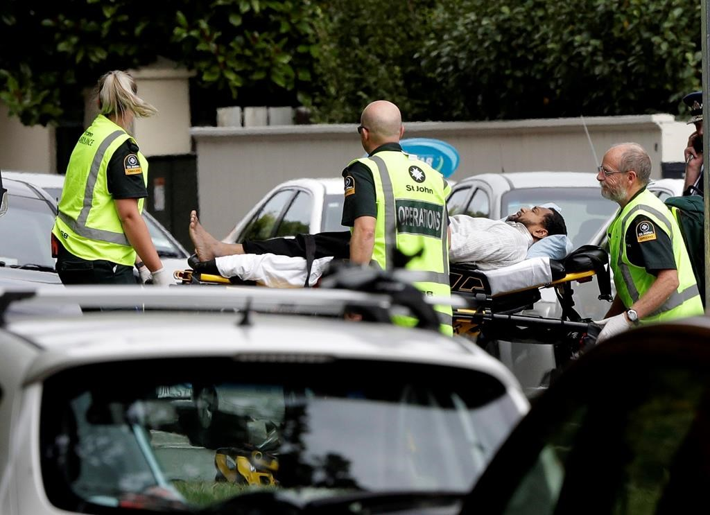 Ambulance staff take a man from outside a mosque in central Christchurch, New Zealand, Friday, March 15, 2019.