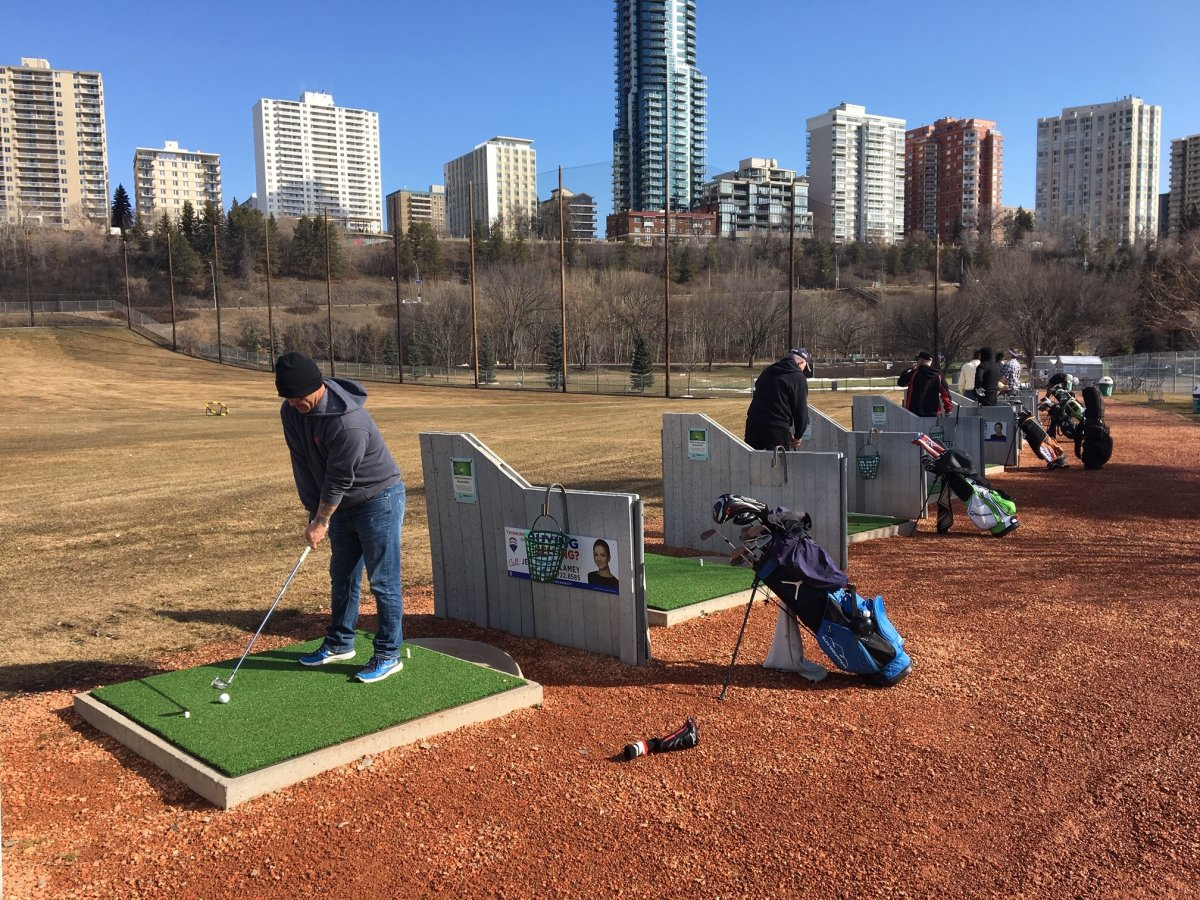 Golfers at the Victoria Golf Driving Range in Edmonton on Wednesday, April 3, 2019.