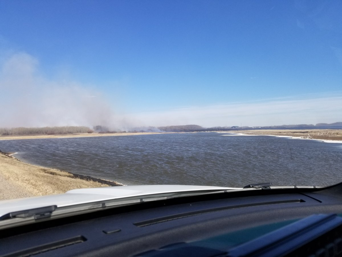 Saskatoon and area firefighters battle blaze on Highway 14 and Range Road 3074 on Saturday afternoon.