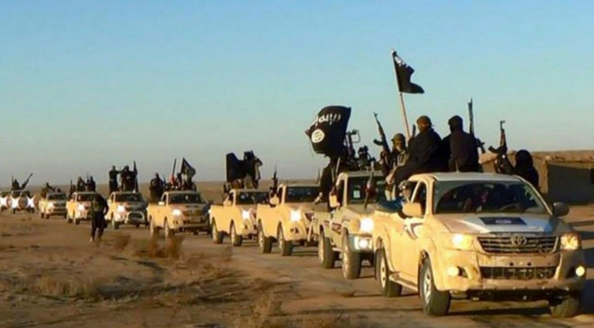 An ISIS convoy on a road leading to Iraq, in Raqqa, Syria, 2014. (Militant photo via AP, File).