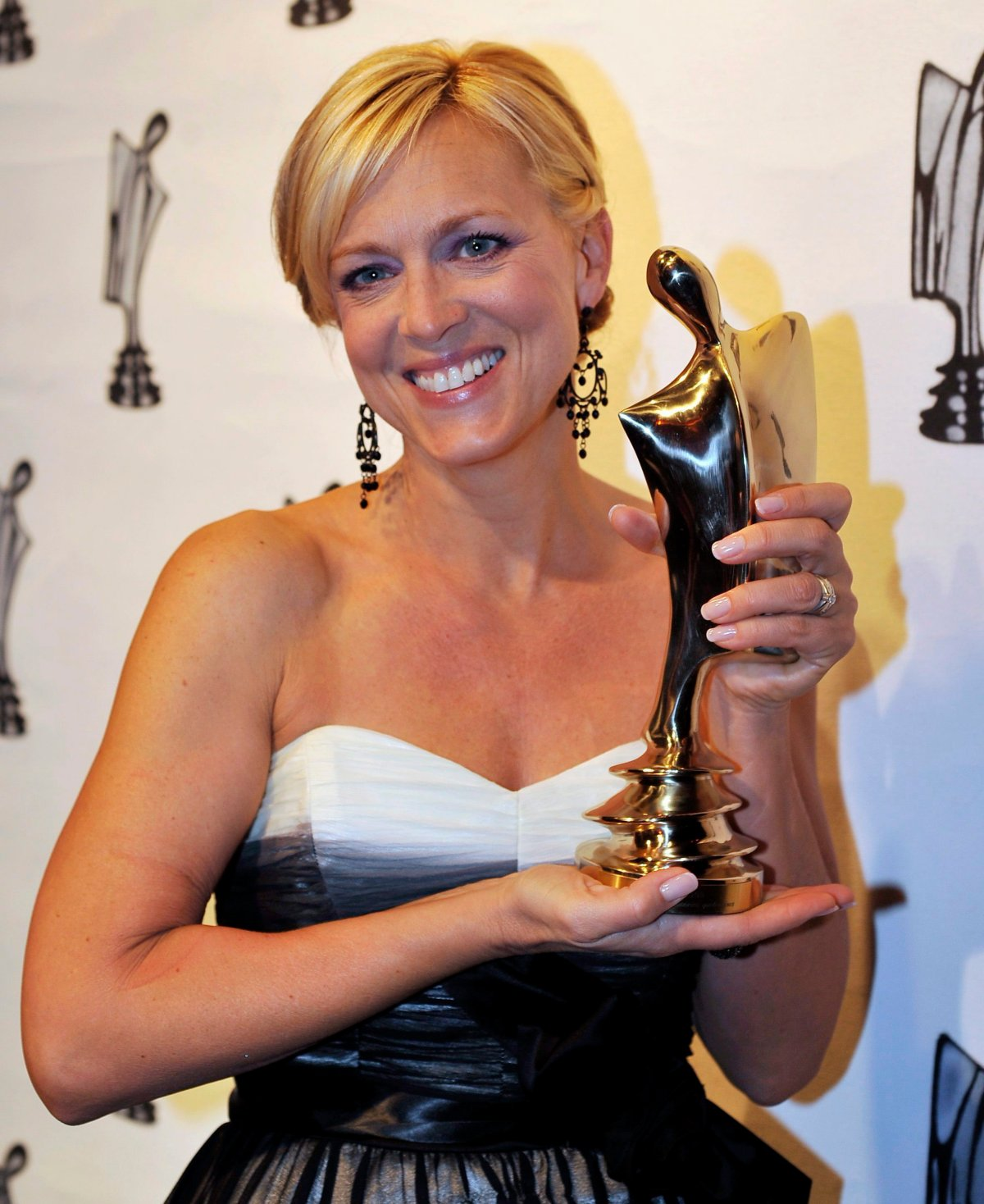 Actress Sophie Pregent holds up her trophy for best actress in a Quebec television series at the Gala Artis awards ceremony in Montreal on April 26, 2009.