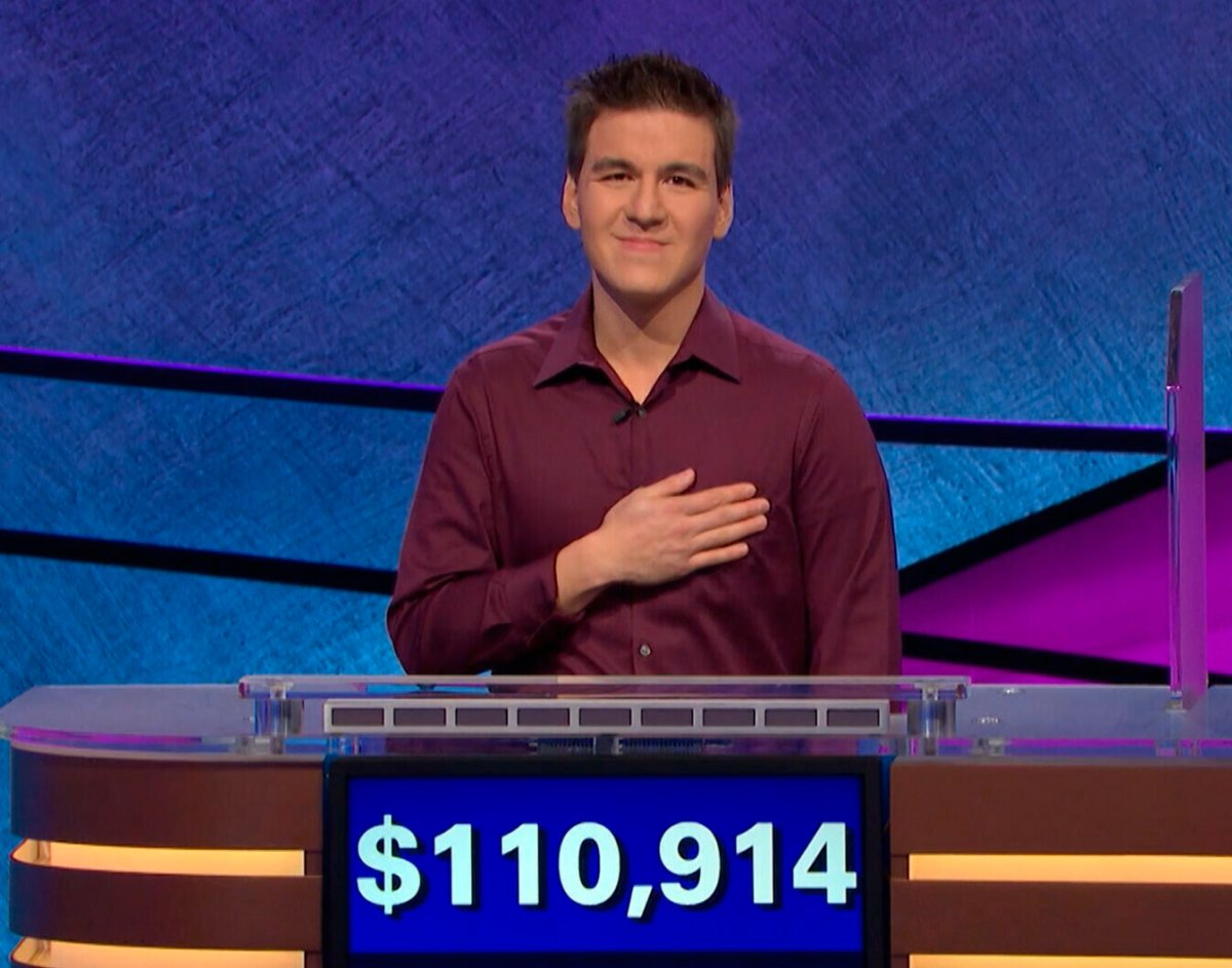 """This image made from video aired on """"Jeopardy!"""" on Tuesday, April 9. 2019, and provided by Jeopardy Productions, Inc. shows James Holzhauer.  The 34-year-old professional sports gambler from Las Vegas won more than $110,000 on """"Jeopardy!"""" on Tuesday, breaking the record for single-day cash winnings."""