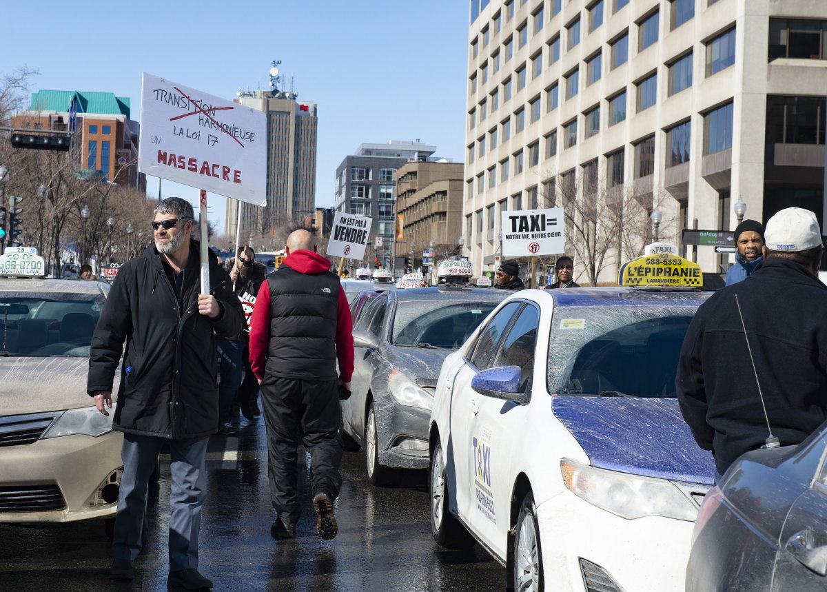 Taxi drivers demonstrate against Bill 17, legislation modifying the taxi industry, Wednesday, April 10, 2019 near the legislature in Quebec City.