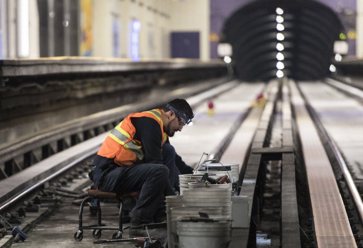 A Montreal Metro maintenance crew works on a track during the early hours of the morning in Montreal, Thursday, April 11, 2019.