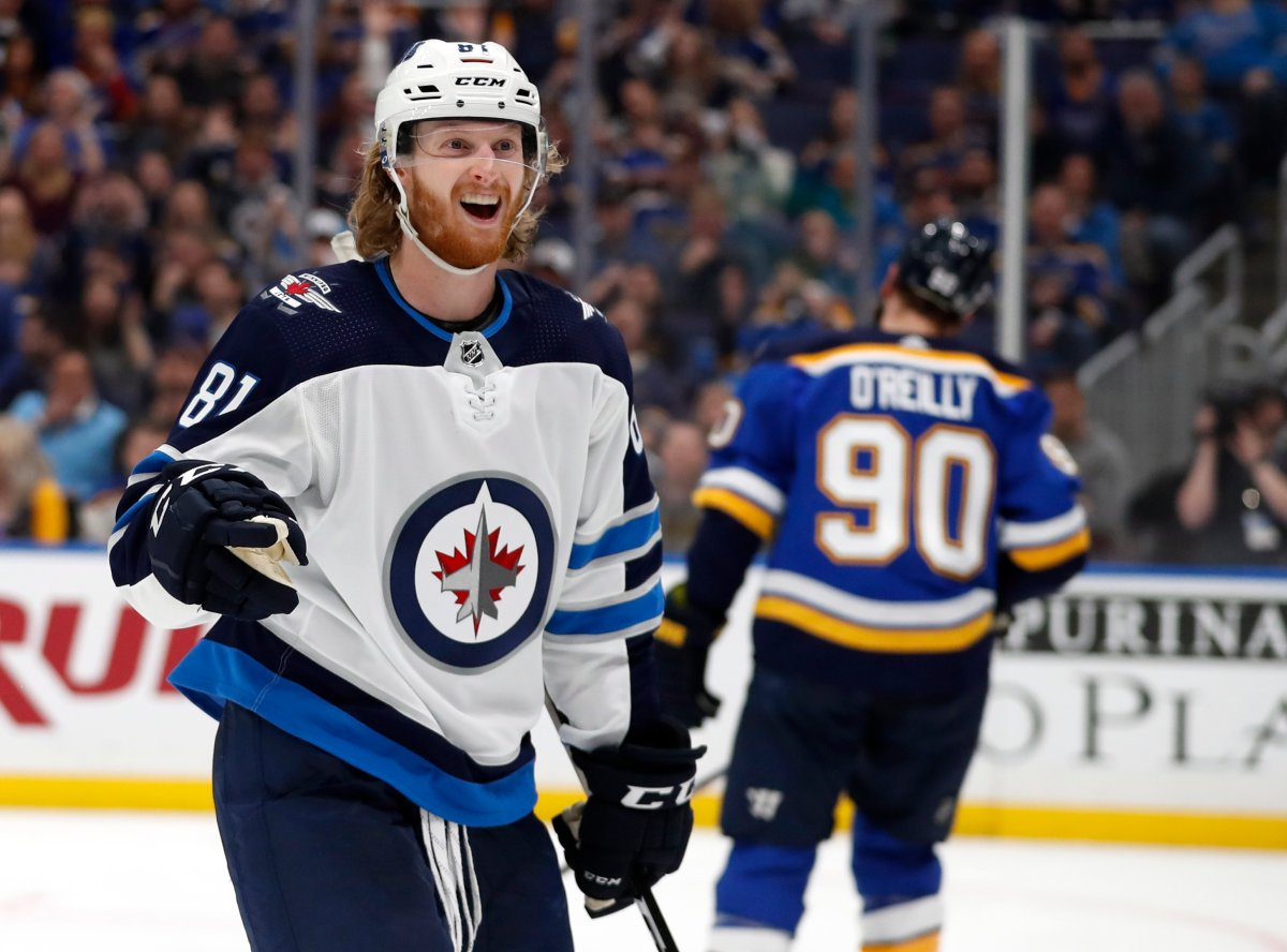 Winnipeg Jets' Kyle Connor celebrates after scoring as St. Louis Blues' Ryan O'Reilly (90) skates in the background during the third period in Game 3 of an NHL first-round hockey playoff series Sunday, April 14, 2019, in St. Louis. The Jets won 6-3.