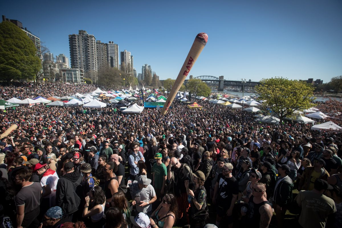 An inflatable shaped like a joint is tossed above the crowd during the annual 4-20 marijuana celebration in Vancouver on Saturday, April 20, 2019.