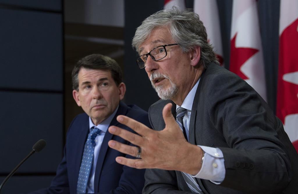 British Columbia Privacy Commissioner Michael McEvoy looks on as Canada's Privacy Commissioner Daniel Therrien (right) speaks during a news conference, Thursday, April 25, 2019 in Ottawa. THE CANADIAN PRESS/Adrian Wyld.