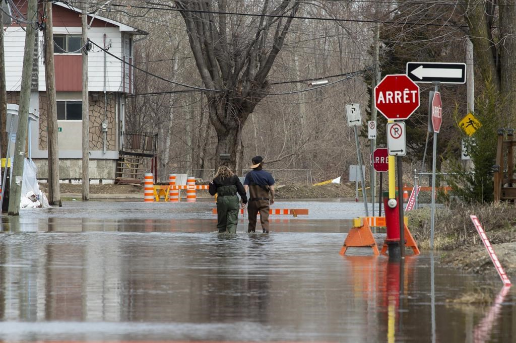 Local residents make their way through flood waters in Gatineau, Que., Tuesday, April 23, 2019.