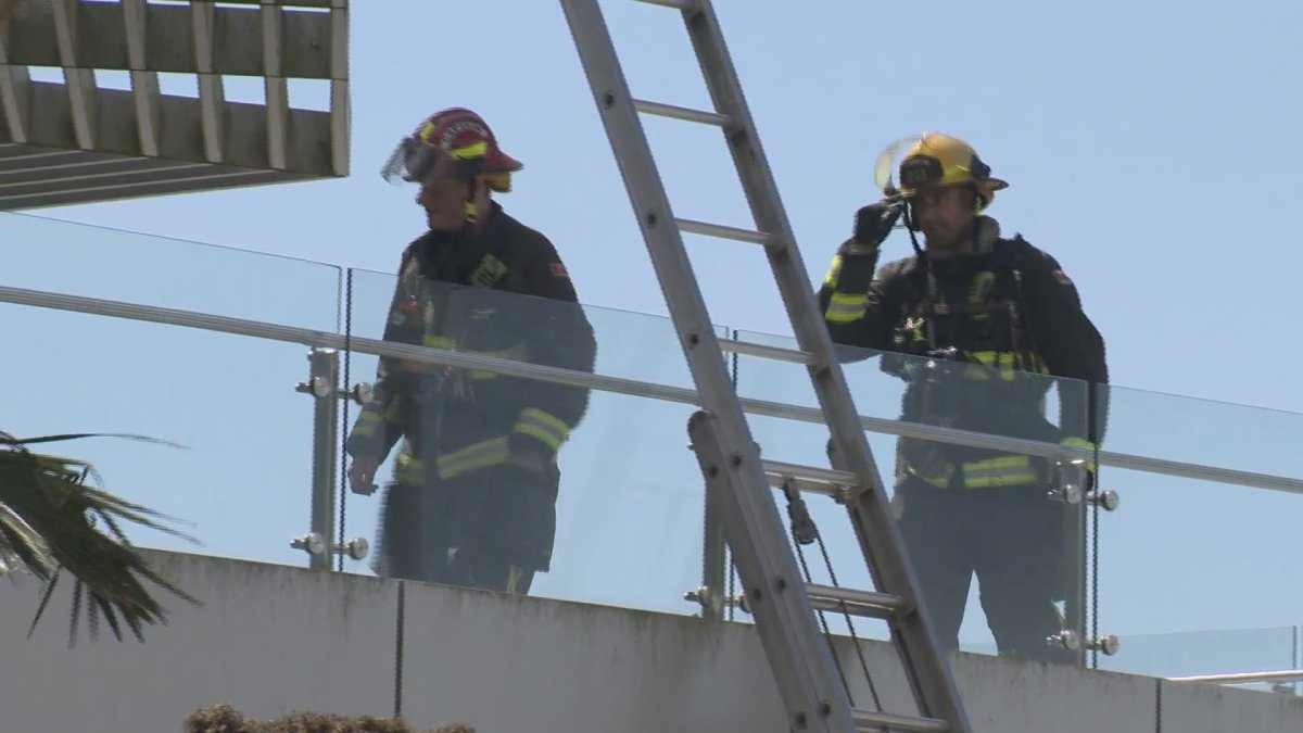 Crews work to extinguish a fire at Beecher Place in Crescent Beach on Monday.