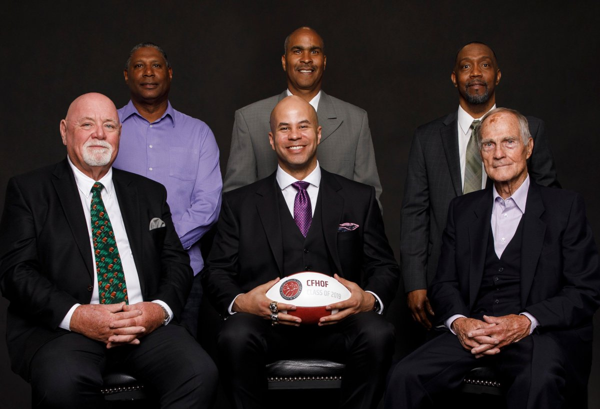 The 2019 class of the Canadian Football Hall of Fame, including (L to R, back row) Mervyn Fernandez, David Williams, Terry Greer, (L to R, front row) Jim Hopson, Jon Cornish and Frank Smith. Not pictured: Ernie Pitts.