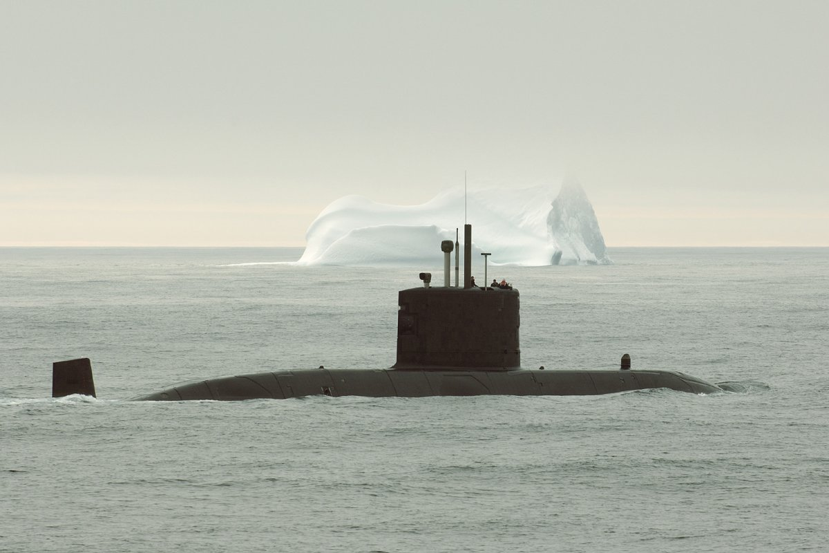 HMCS Corner Brook on arctic patrol during OP Nanook sails past an Iceberg.