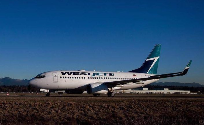A Westjet Boeing 737-700 taxis to a gate after arriving at Vancouver International Airport in Richmond, B.C., on February 3, 2014.