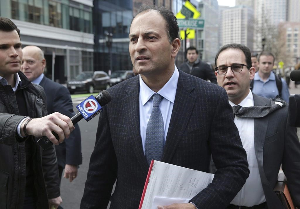 David Sidoo, of Vancouver, Canada, leaves following his federal court hearing Friday, March 15, 2019, in Boston. Sidoo faces an additional charge of conspiracy to commit money laundering for his alleged role in a college admissions scandal in the United States.