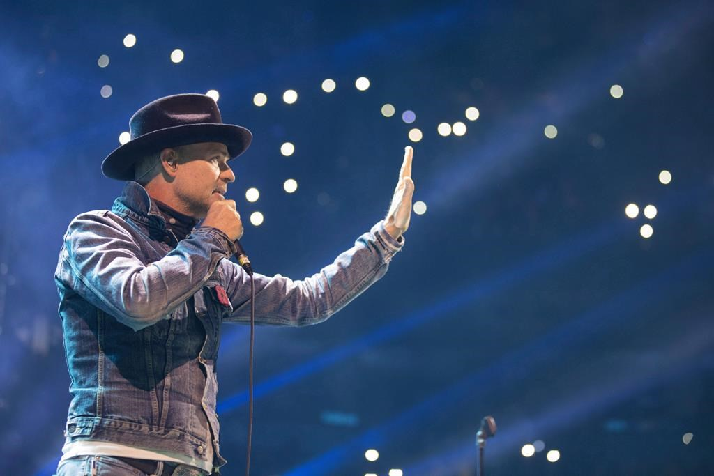 Gord Downie performs at WE Day in Toronto on Wednesday, October 19, 2016. People are invited to sing The Hip's 'Bobcaygeon' to support the village during the coronavirus pandemic.