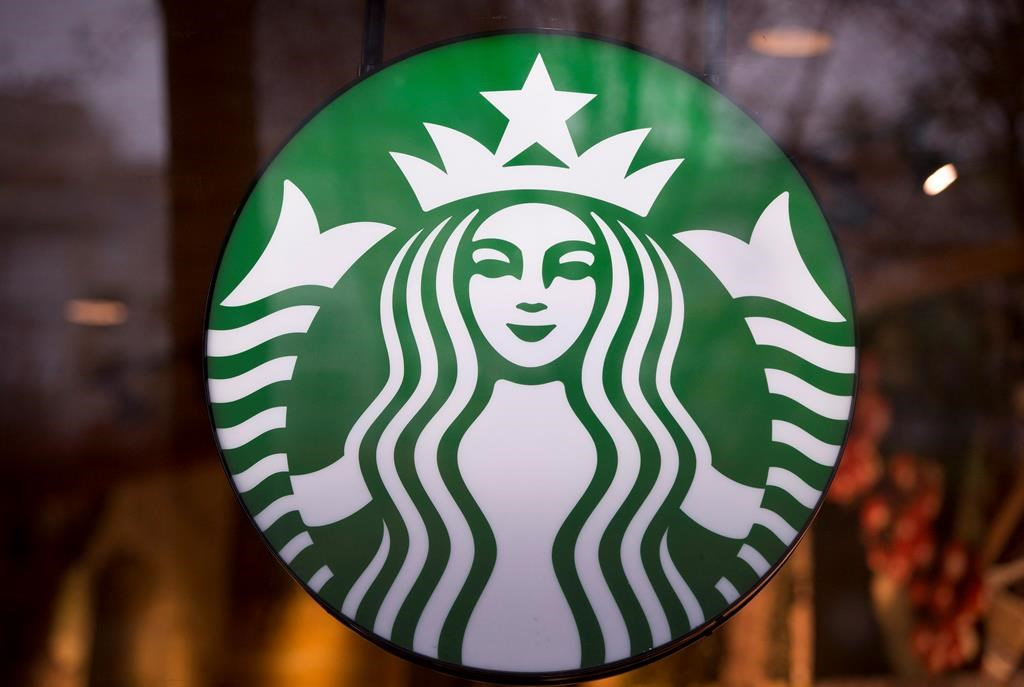 A Starbucks sign is pictured in downtown Vancouver on March 20, 2015.