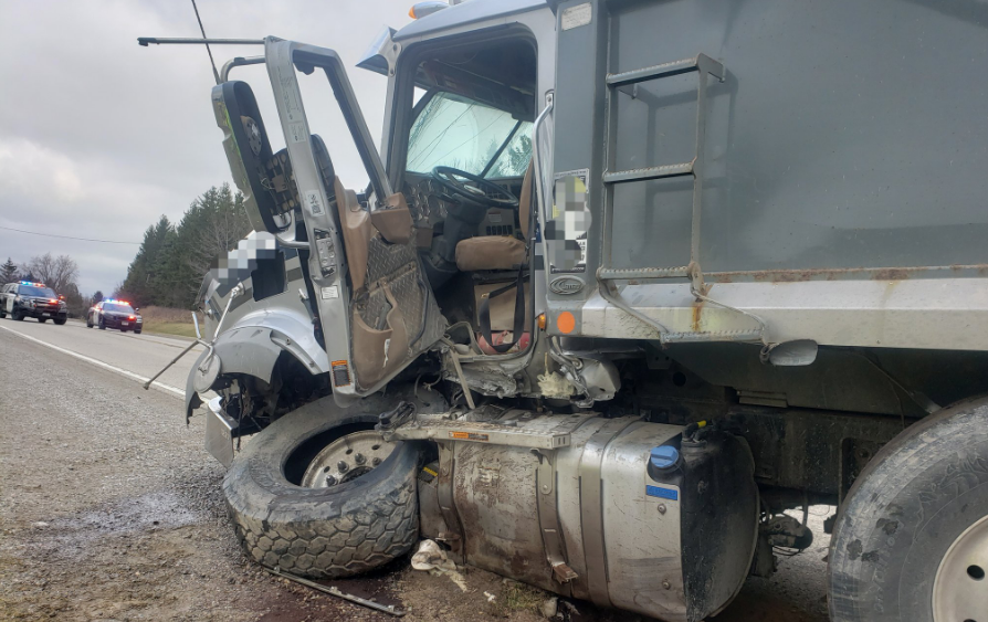 Police say a dump truck collided with a tractor trailer on Highway 2 west of Puttown Road just before 830 a.m. Tuesday.