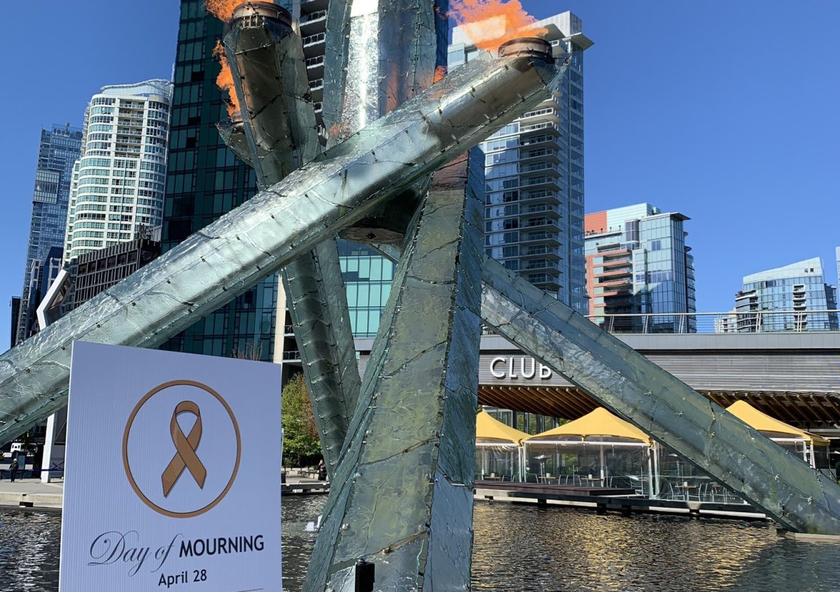 The Olympic Cauldron at Jack Poole Plaza in downtown Vancouver is lit in honour of workers killed or injured on the job during the National Day of Mourning ceremony Sunday, April 28, 2019.