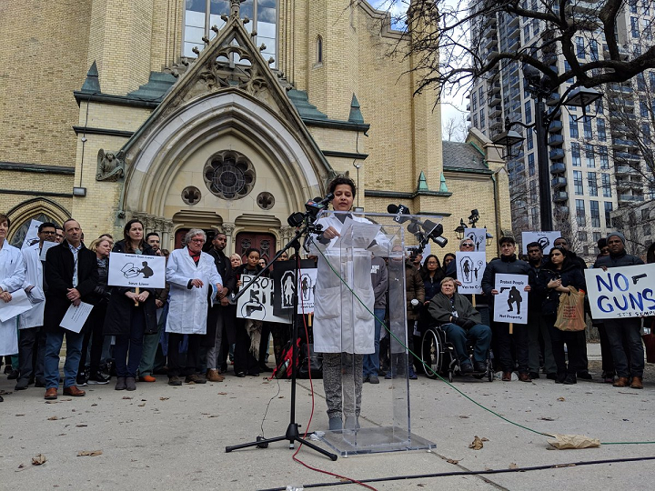 Dr. Najma Ahmed speaking to healthcare professionals at a Toronto rally in favour of gun control on Wednesday.