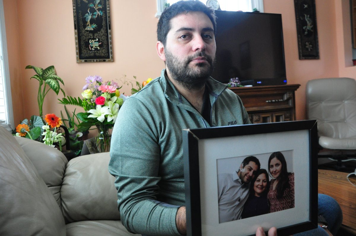 Oliver Antonio Munoz Orellana holds a picture of himself with his mother Tamara Orellana Azolas, centre, and his sister.