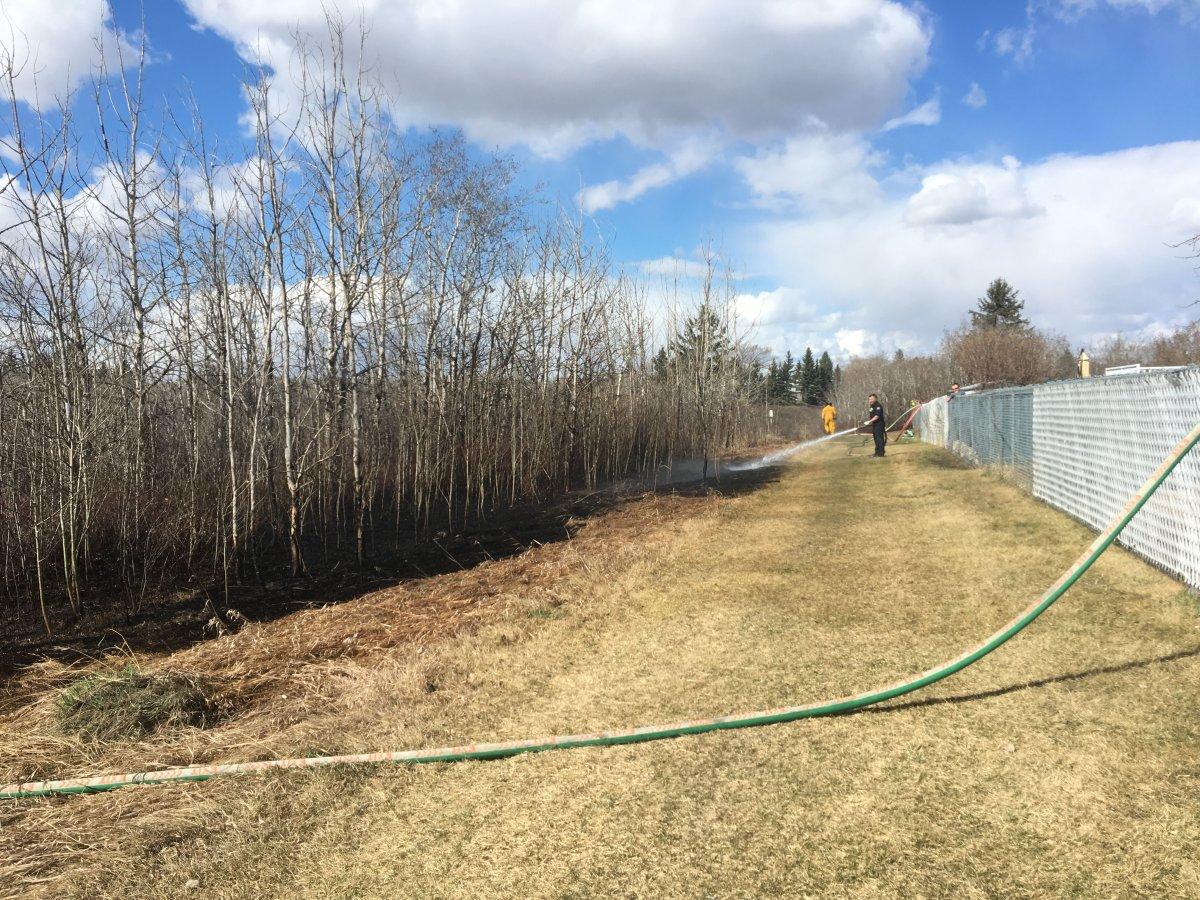 Edmonton fire crews battle a brush fire at a northeast ravine, Saturday, April 20, 2019.