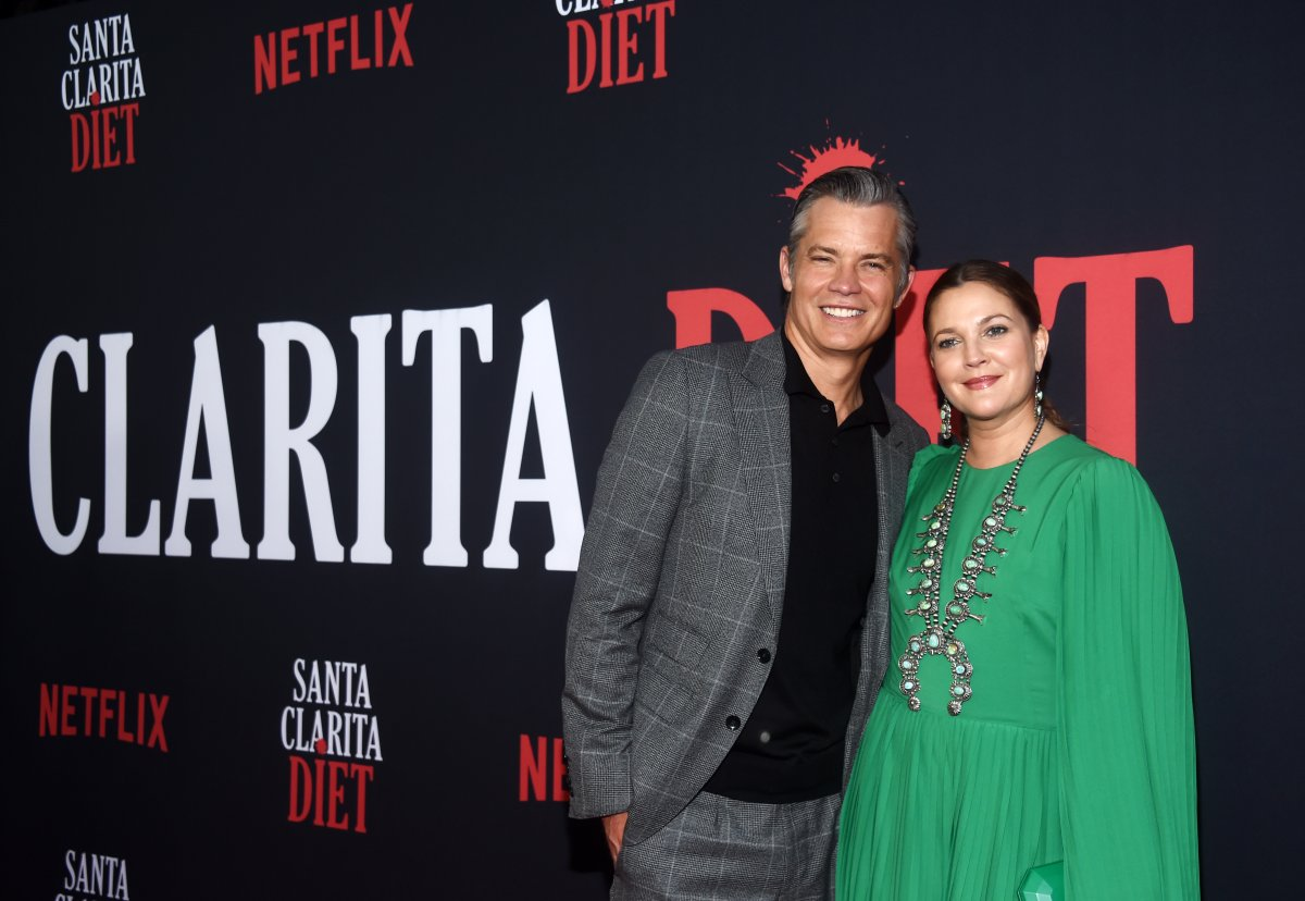 Timothy Olyphant (L) and Drew Barrymore arrive at Netflix's 'Santa Clarita Diet' Season 3 premiere at Hollywood Post 43 on March 28, 2019 in Los Angeles, Calif.