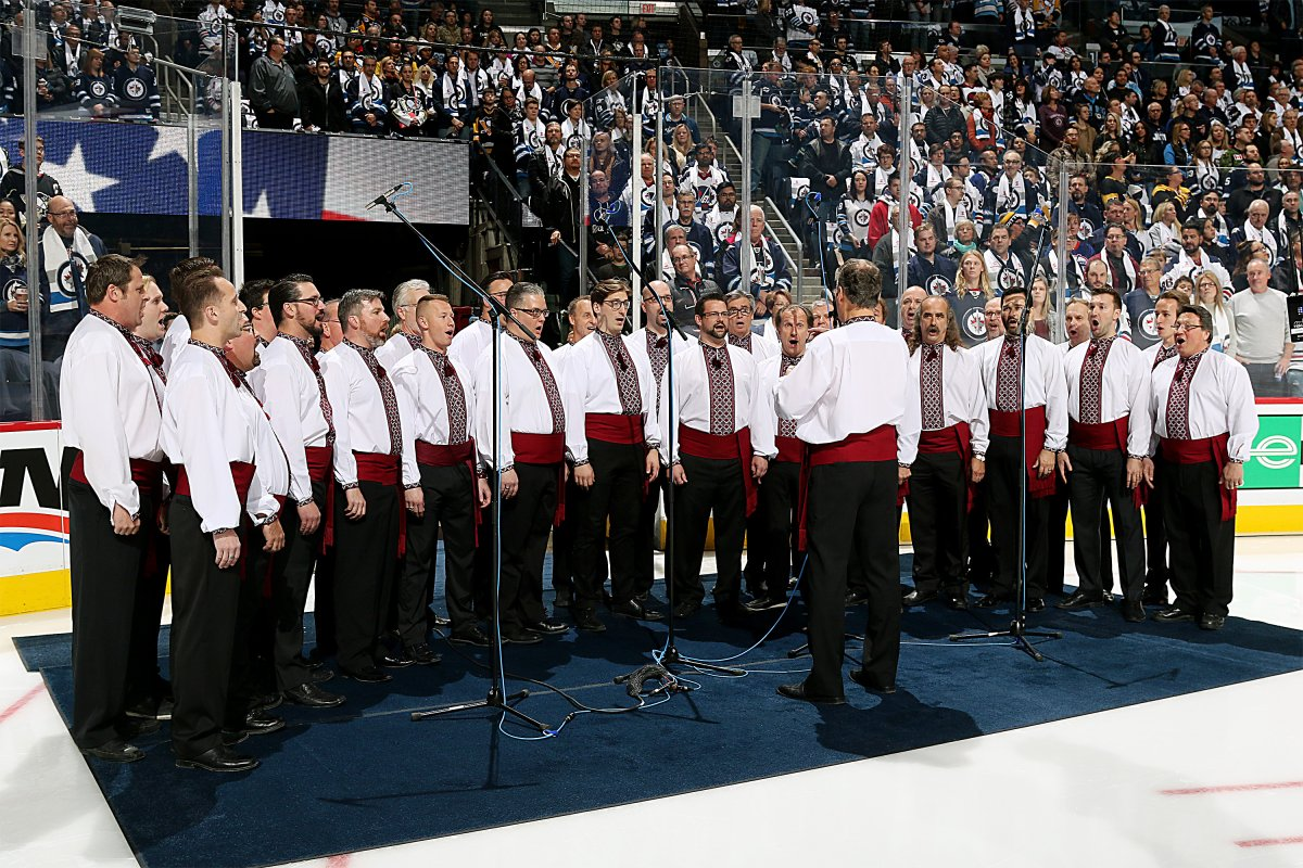 WINNIPEG, MB - OCTOBER 29: The Hoosli Ukrainian Male Chorus performs the National anthems prior to NHL action between the Winnipeg Jets and the Pittsburgh Penguins at the Bell MTS Place on October 29, 2017 in Winnipeg, Manitoba, Canada.